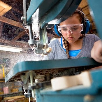 girl focusing on woodworking
