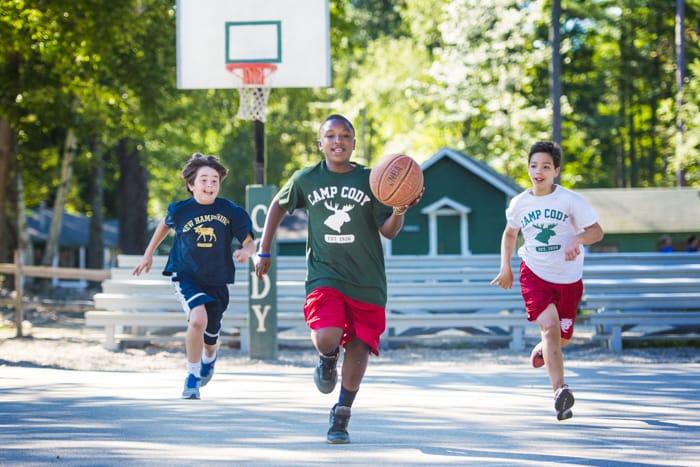 boys playing basketball at summer camp