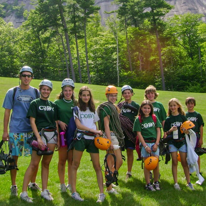 young of campers and instructors with rock climbing gear