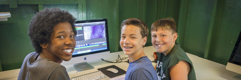 boys using computer at summer camp