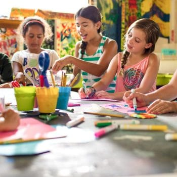 young girls painting and coloring