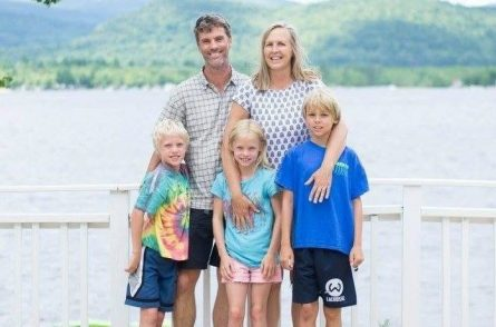 family standing in front of Ossipee Lake