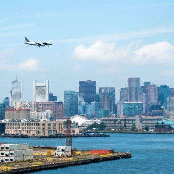 airplane flying over boston