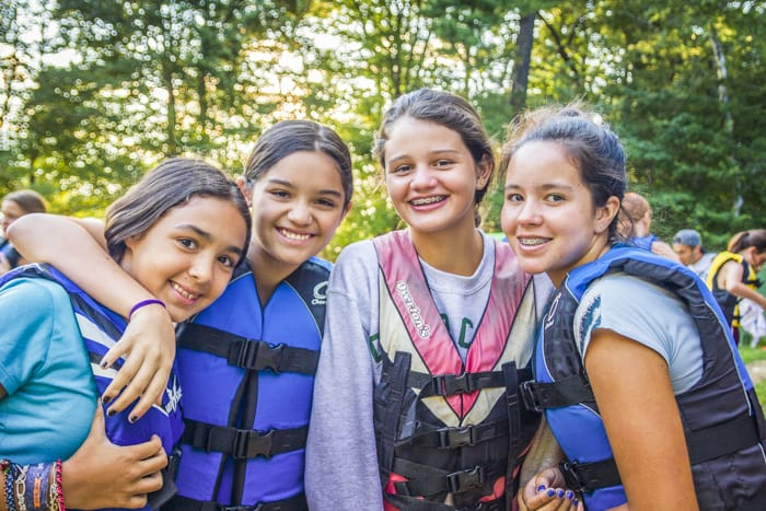 group of girls at summer camp in life vests