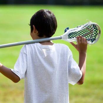 boy holding a lacrosse stick