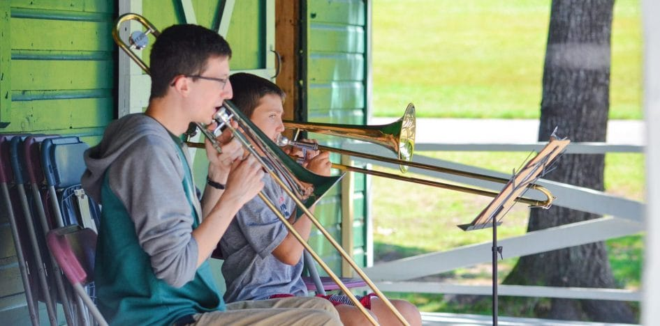two kids playing trumpets
