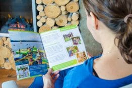 girl reading camp cody brochure