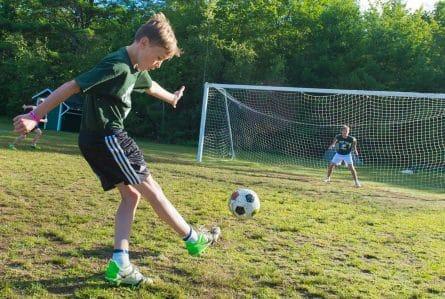 kids playing soccer at summer camp