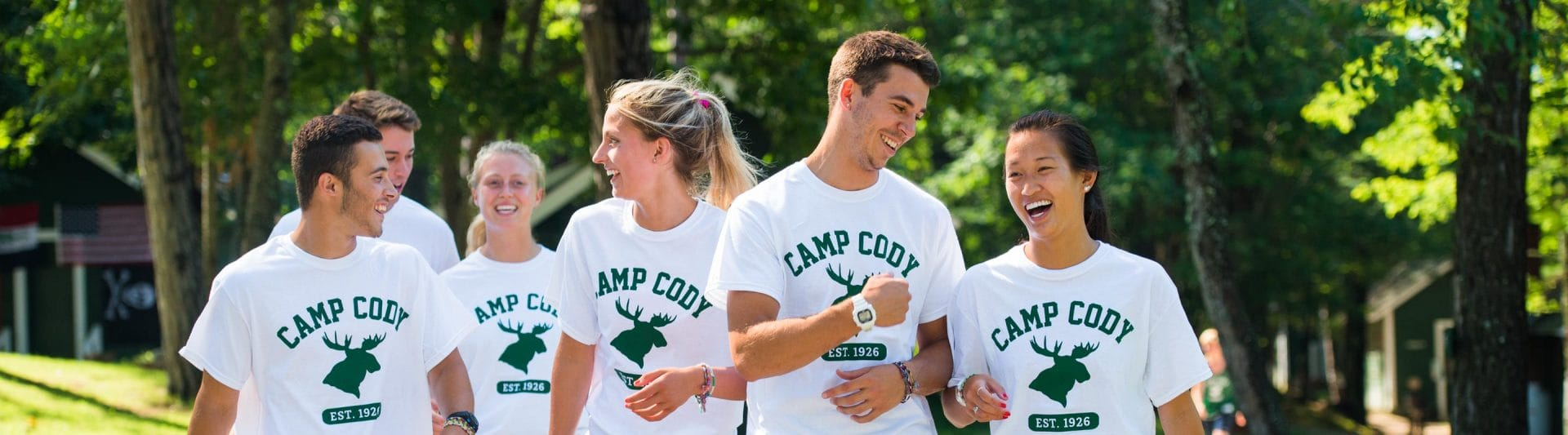 a group of counselors walking together and smiling