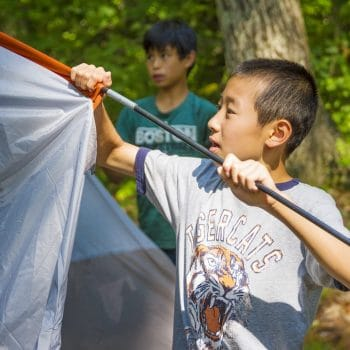 boy pitching a tent