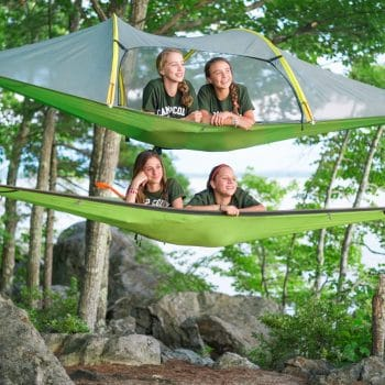 girls relaxing in the air in hammocks