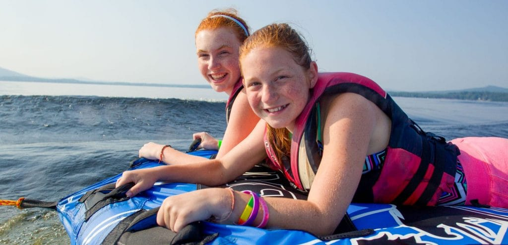 girls about to go tubing in ocean