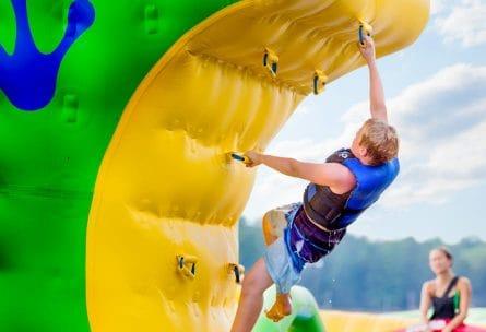 boy climbing raft