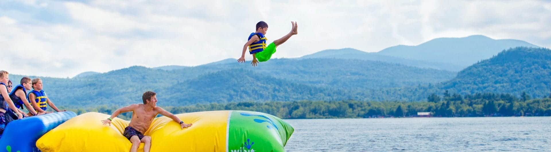 young boy on the blob at camp cody