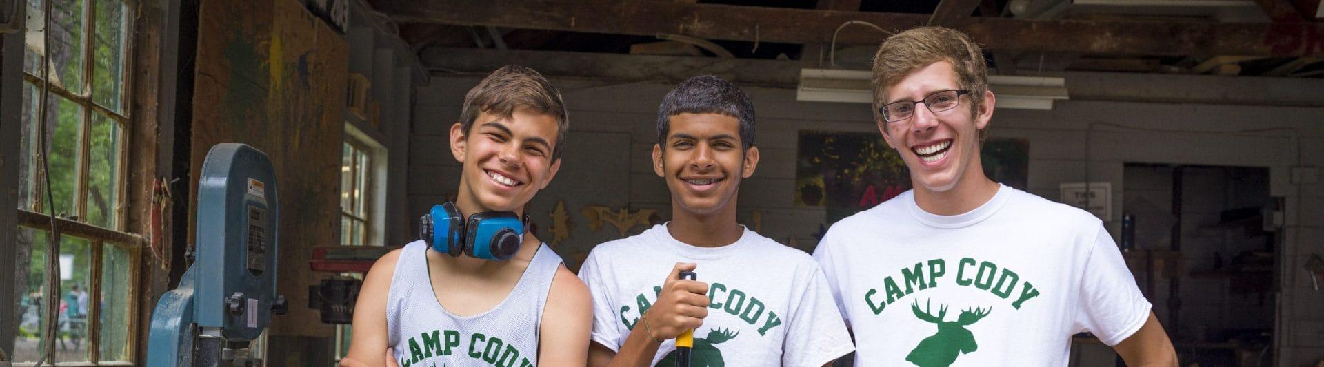 three guys smiling at the camera