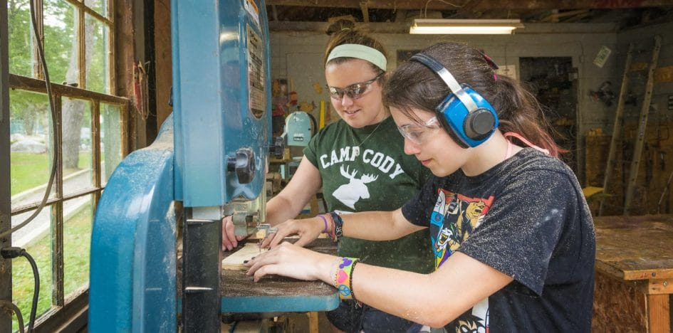 two girls wood working