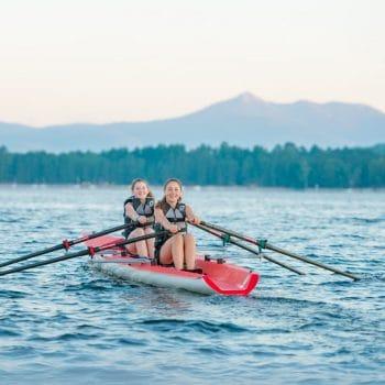 two girls kayaking in lake
