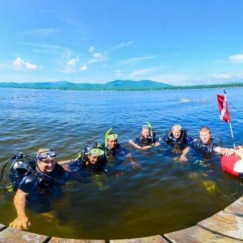 kids scuba diving at summer camp