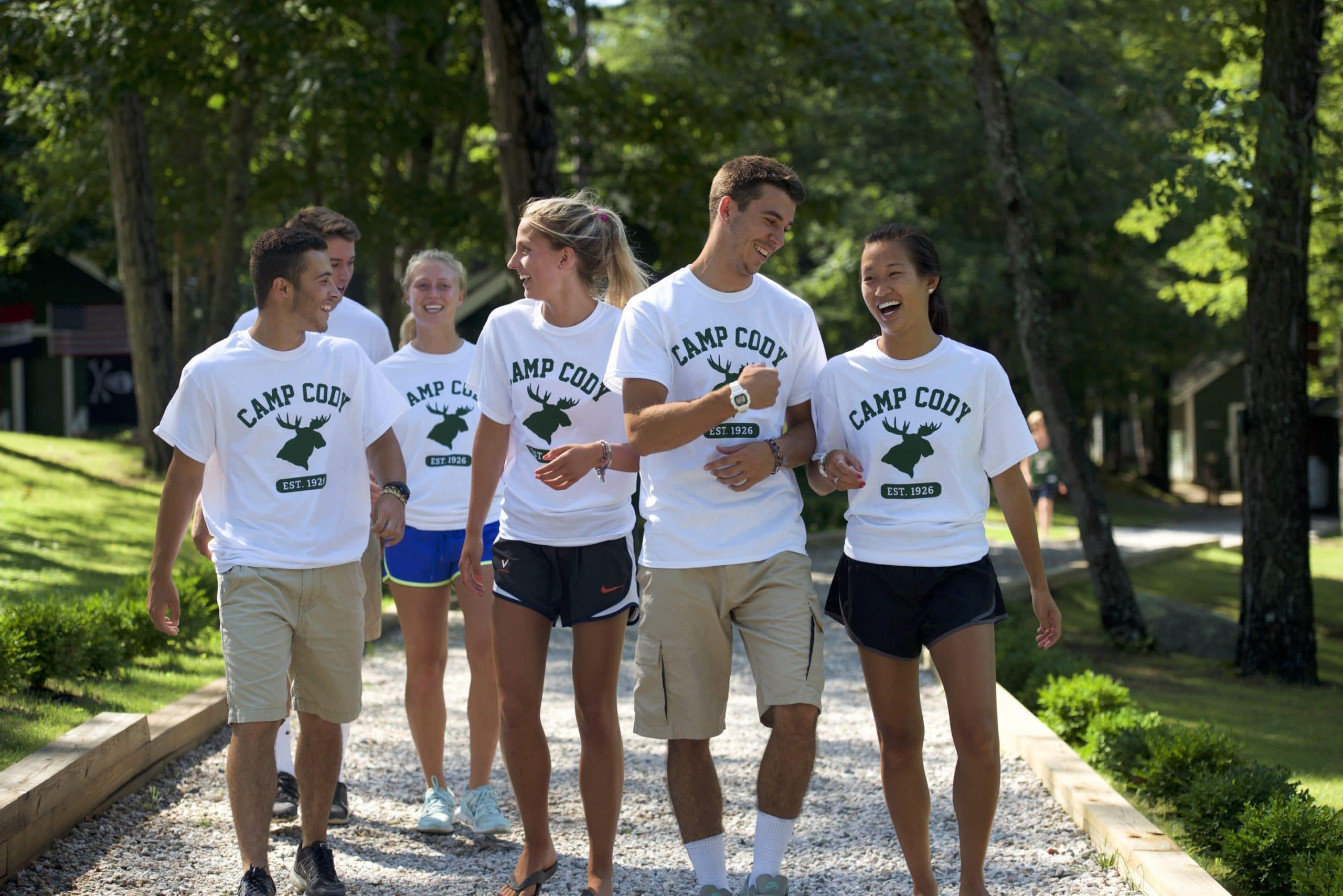 group of counselors walking together and smiling