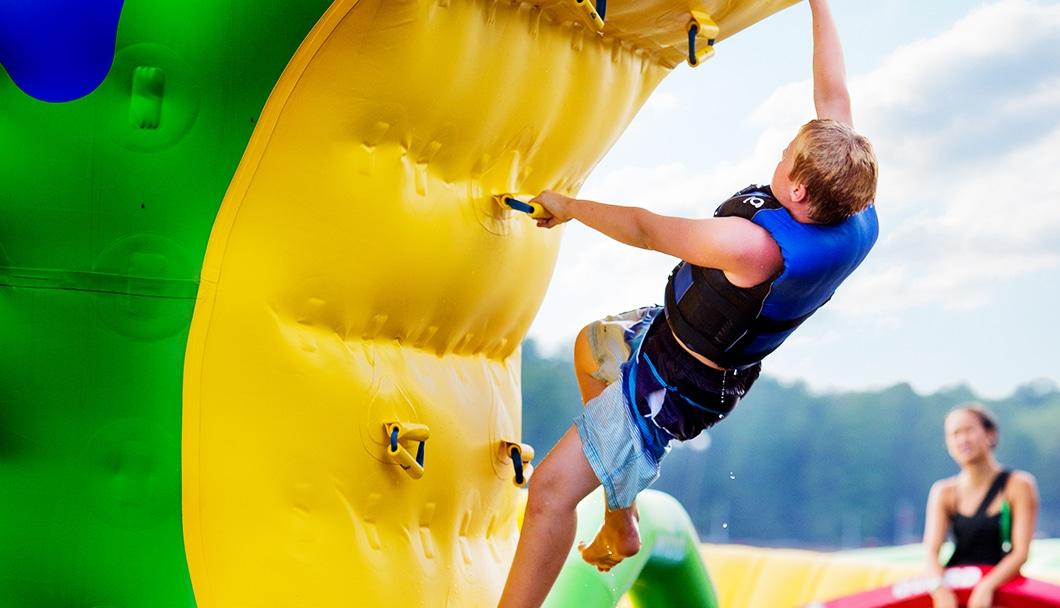 boy climbing a wibit