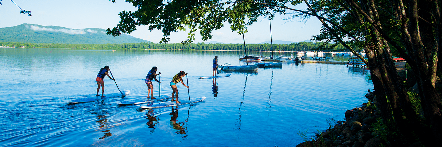 a group of people paddle boarding